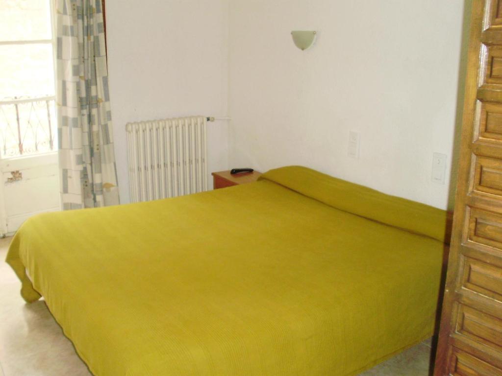 Cama o camas de una habitación en Skipass Hostal