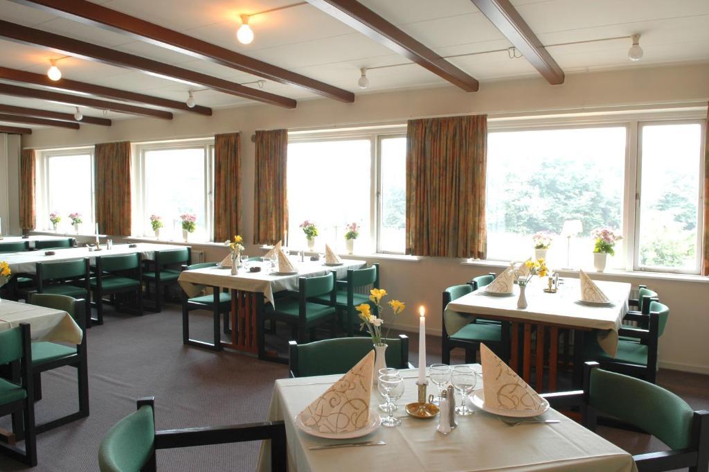 Een restaurant of ander eetgelegenheid bij Hotel Medio Apartments
