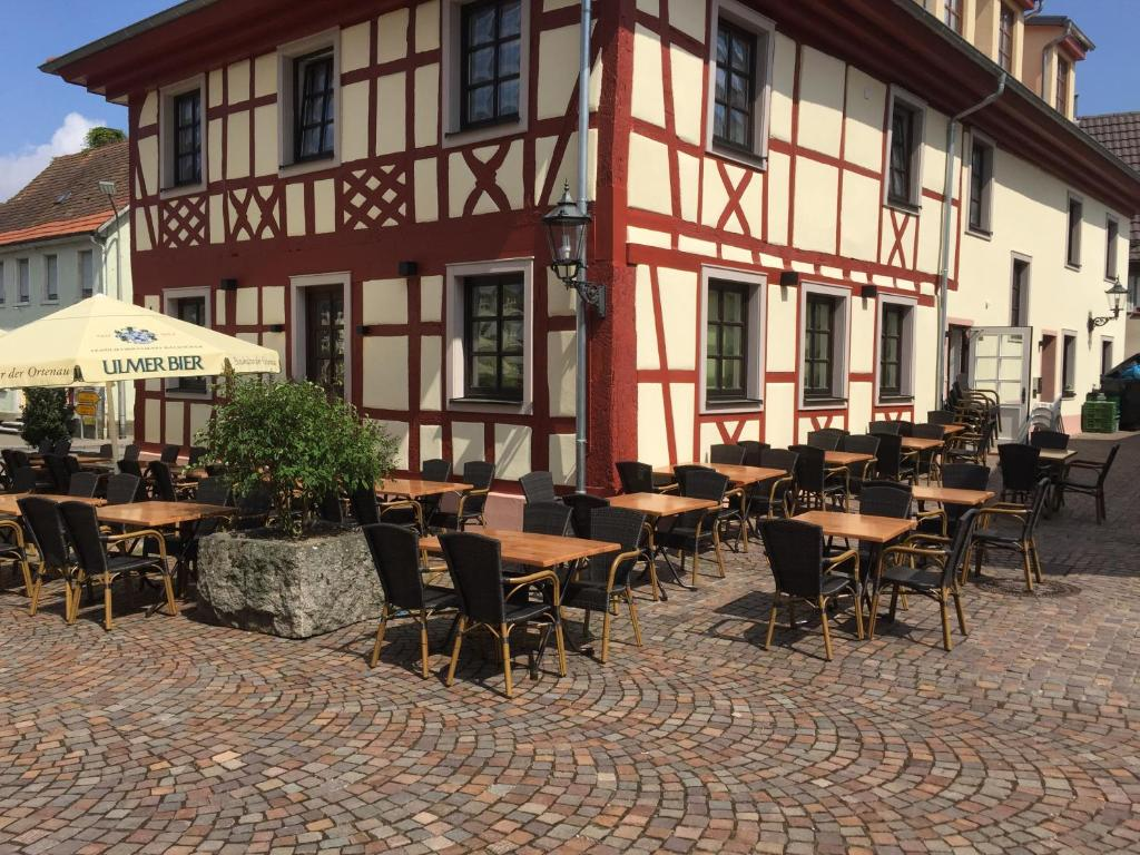 """A restaurant or other place to eat at Hotel - Restaurant """"Am Münster"""""""