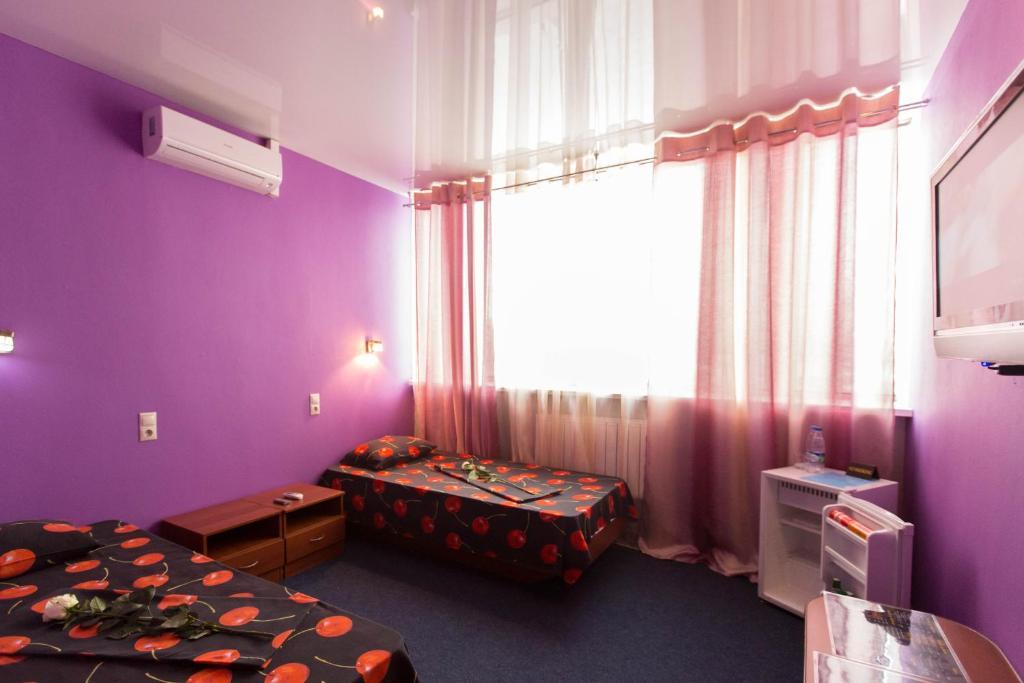 Кровать или кровати в номере Hotel Complex Pervomayskiy