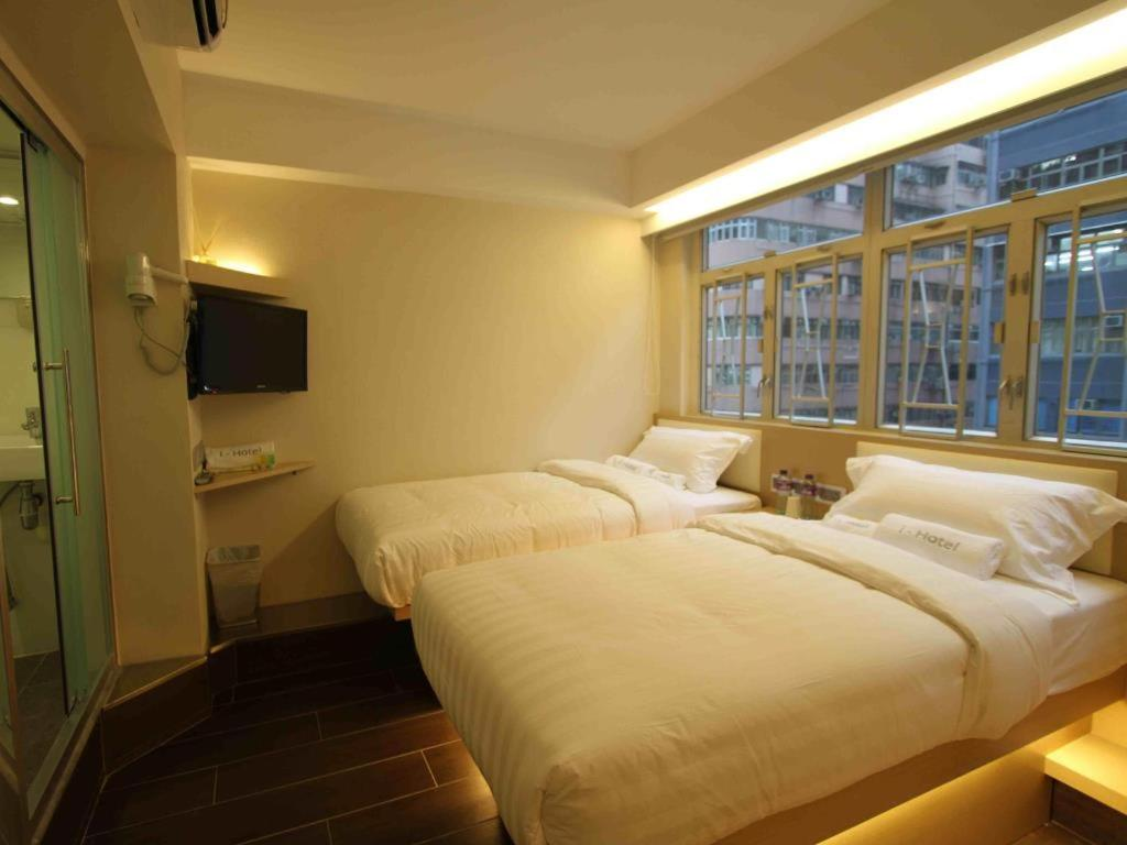 A bed or beds in a room at i-Hotel