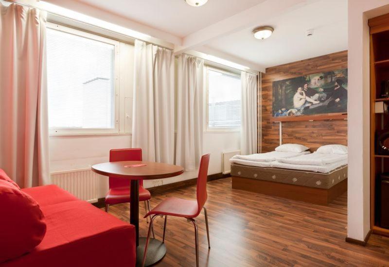 Säng eller sängar i ett rum på Omena Hotel Seinäjoki