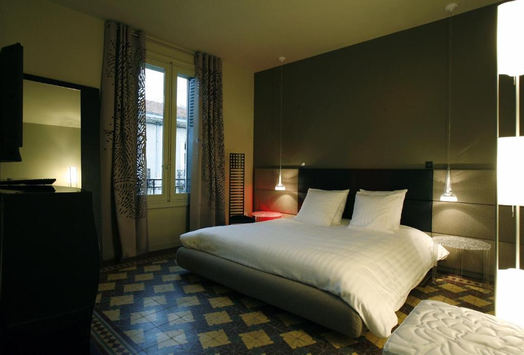 A bed or beds in a room at Les 4 étoiles