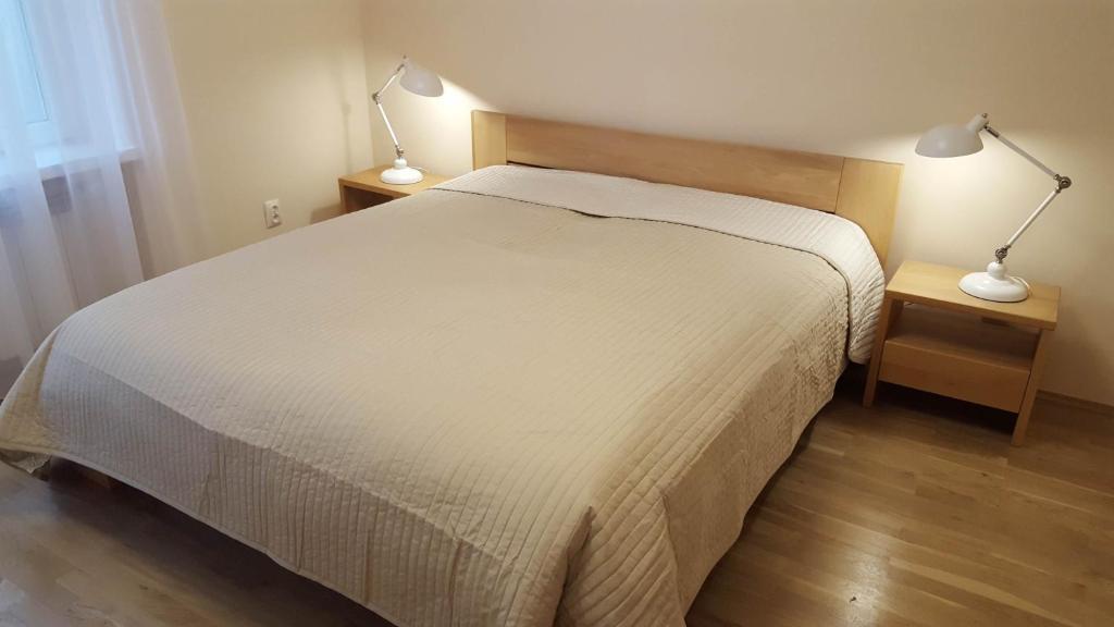 Ein Bett oder Betten in einem Zimmer der Unterkunft Katamaran Apartment
