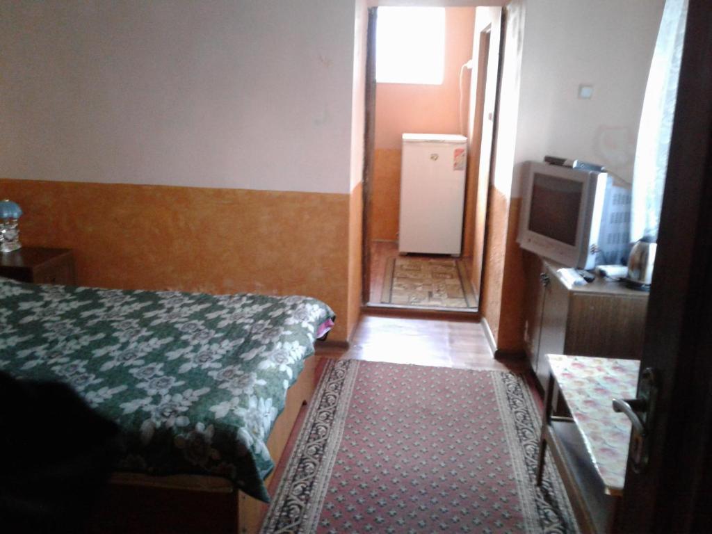 Кровать или кровати в номере Гостиница Лидия
