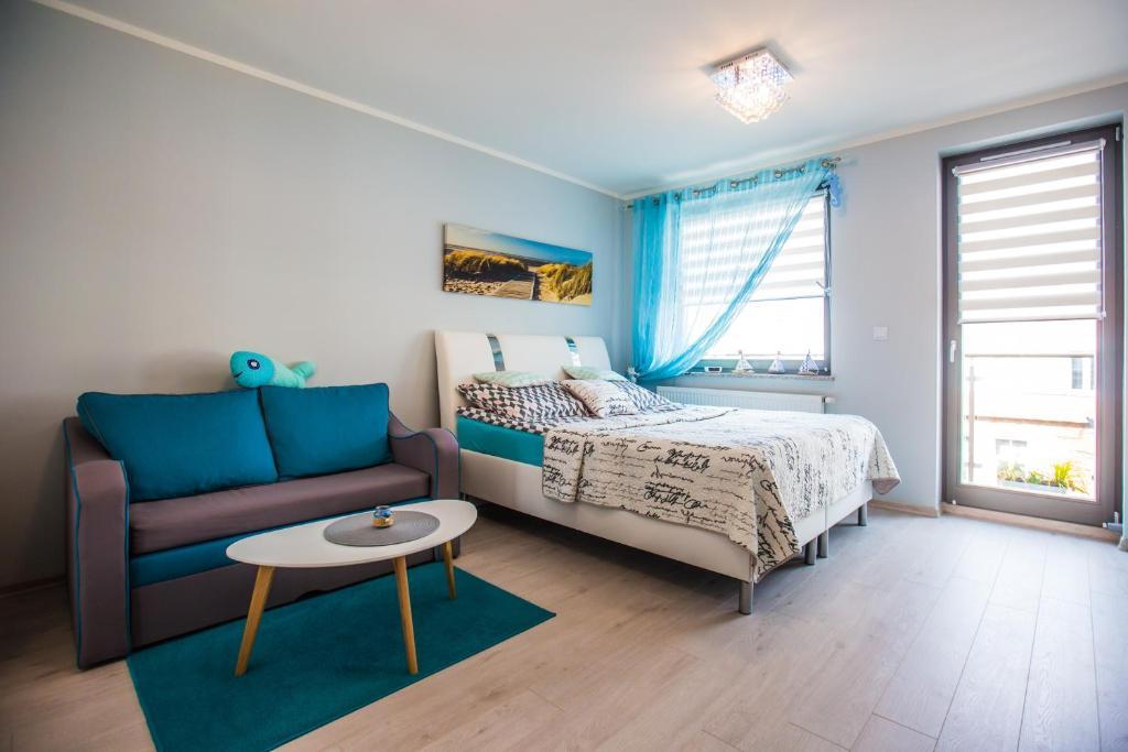 Łóżko lub łóżka w pokoju w obiekcie Apartament Kompas