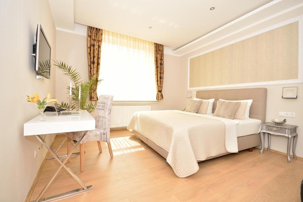 Ein Bett oder Betten in einem Zimmer der Unterkunft Hotel Stadt Bremen