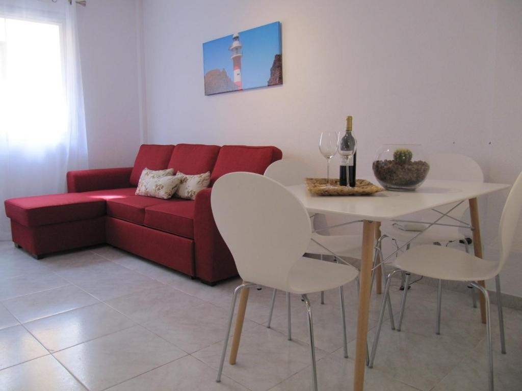 A seating area at Apartamentos Punta Carero