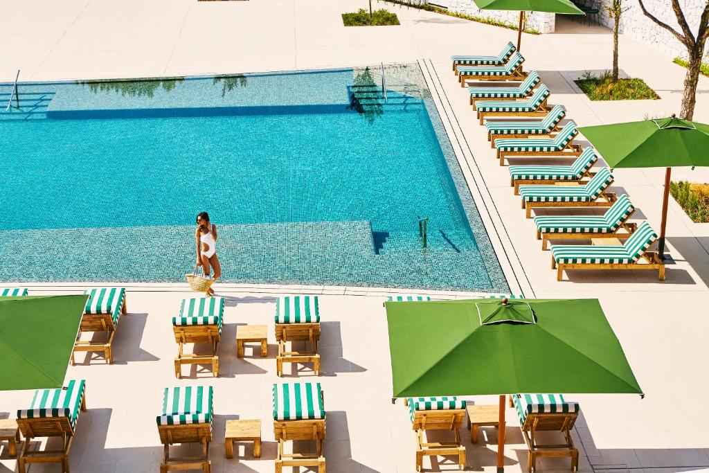A view of the pool at Hotel Camiral at PGA Catalunya or nearby