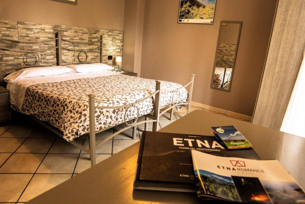 A bed or beds in a room at Sotto Il Vulcano