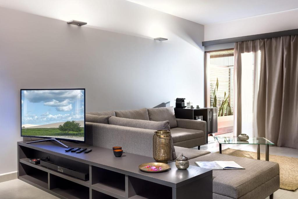 A television and/or entertainment center at Essenza Dune Hotel