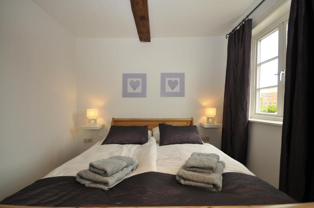 Ein Bett oder Betten in einem Zimmer der Unterkunft Gasthaus Heidelux