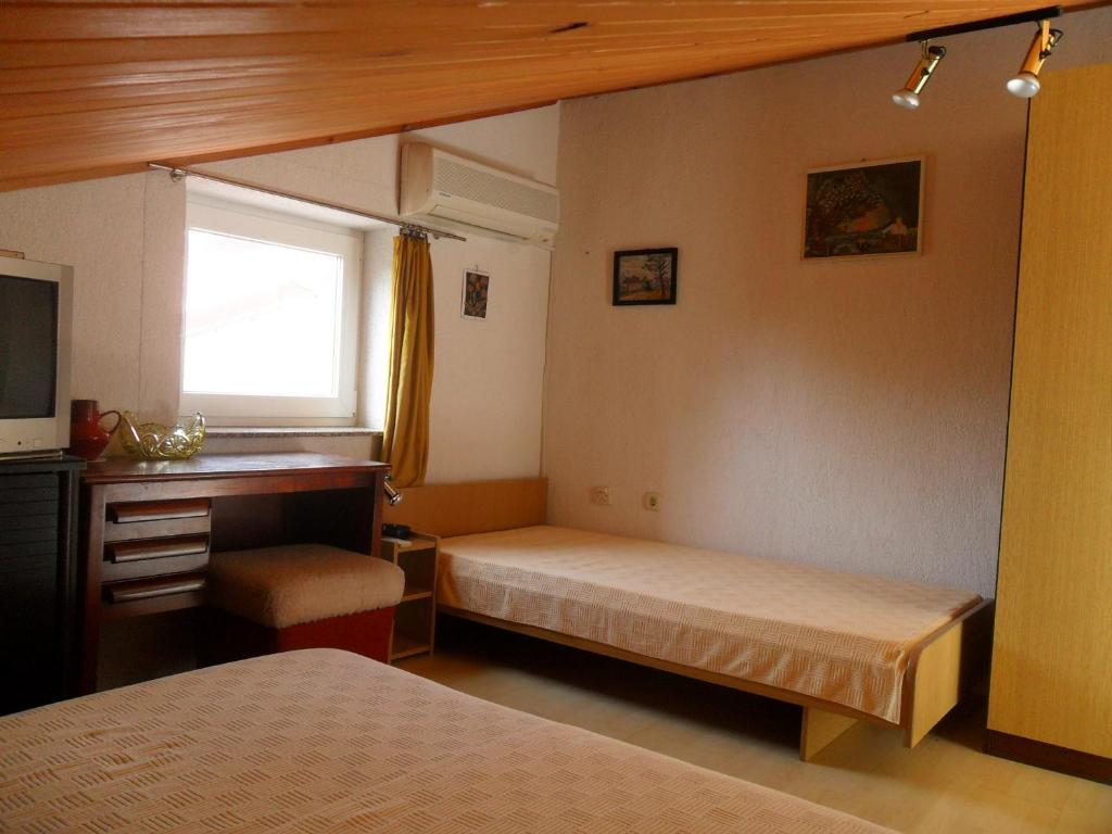A bed or beds in a room at Apartments Simpa