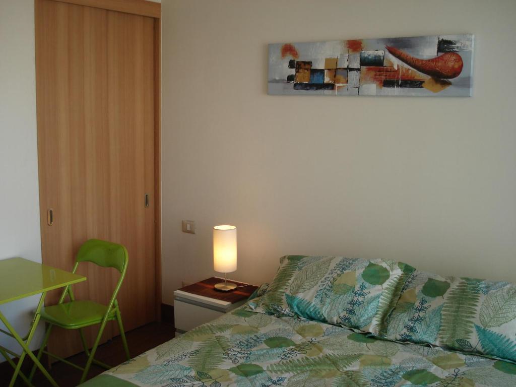 Cama o camas de una habitación en Santiago Downtown Apartments Moneda II
