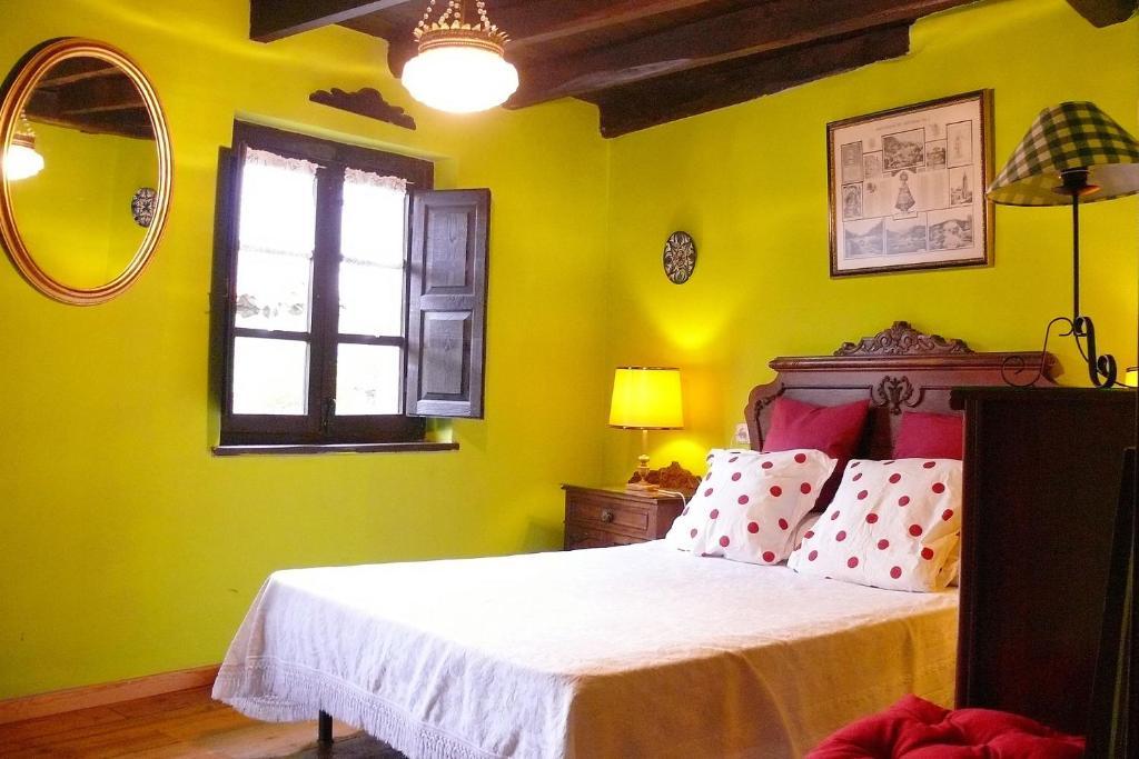 Cama o camas de una habitación en La Casina de Celorio