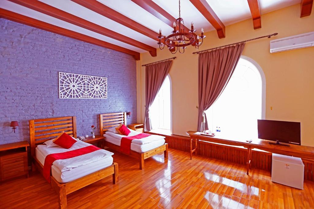 A television and/or entertainment center at Hotel Malika Bukhara