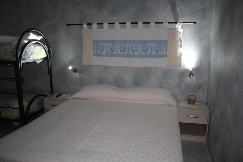 A bed or beds in a room at La Pavoncella