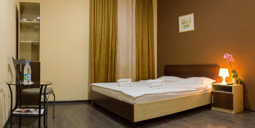Кровать или кровати в номере Отель Новокосино