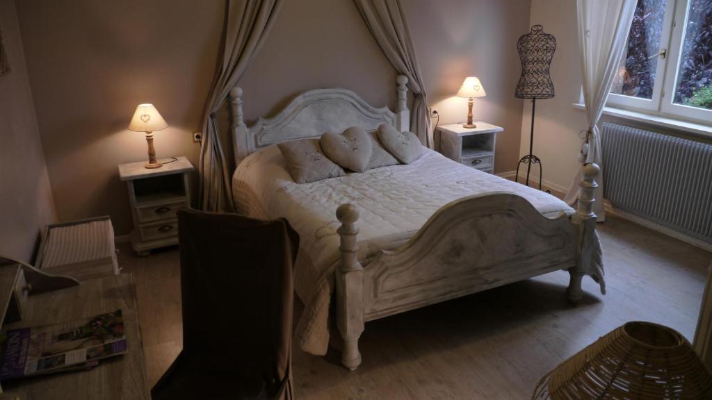 Un ou plusieurs lits dans un hébergement de l'établissement Chambres d'hôtes L'Ecrin des Saveurs