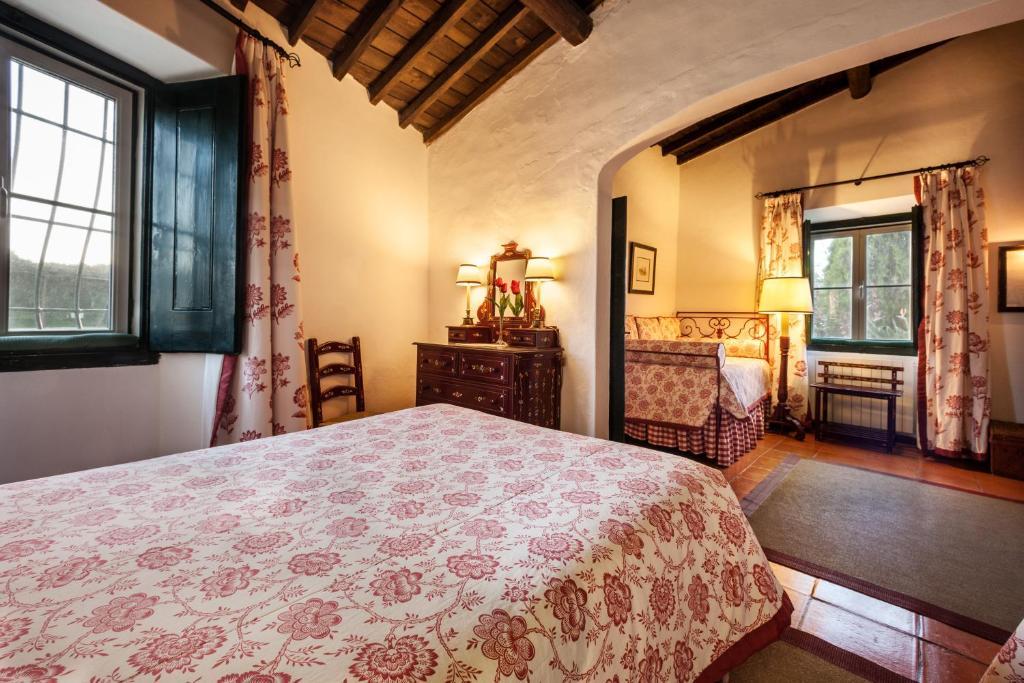 En eller flere senge i et værelse på Quinta Da Espada