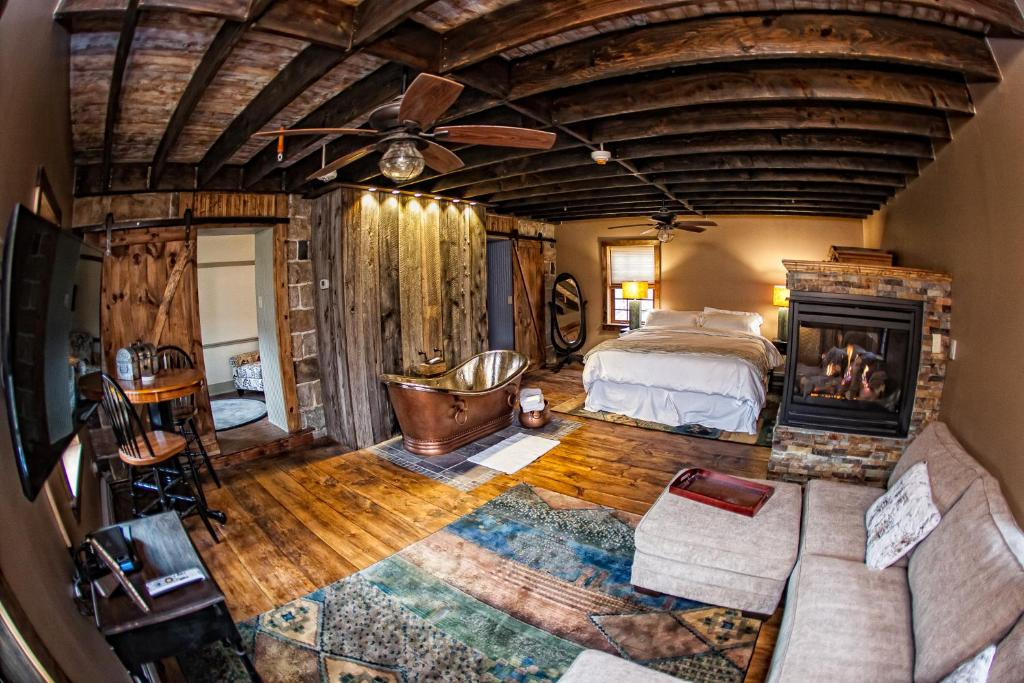 A bed or beds in a room at The Inn at Birch Wilds