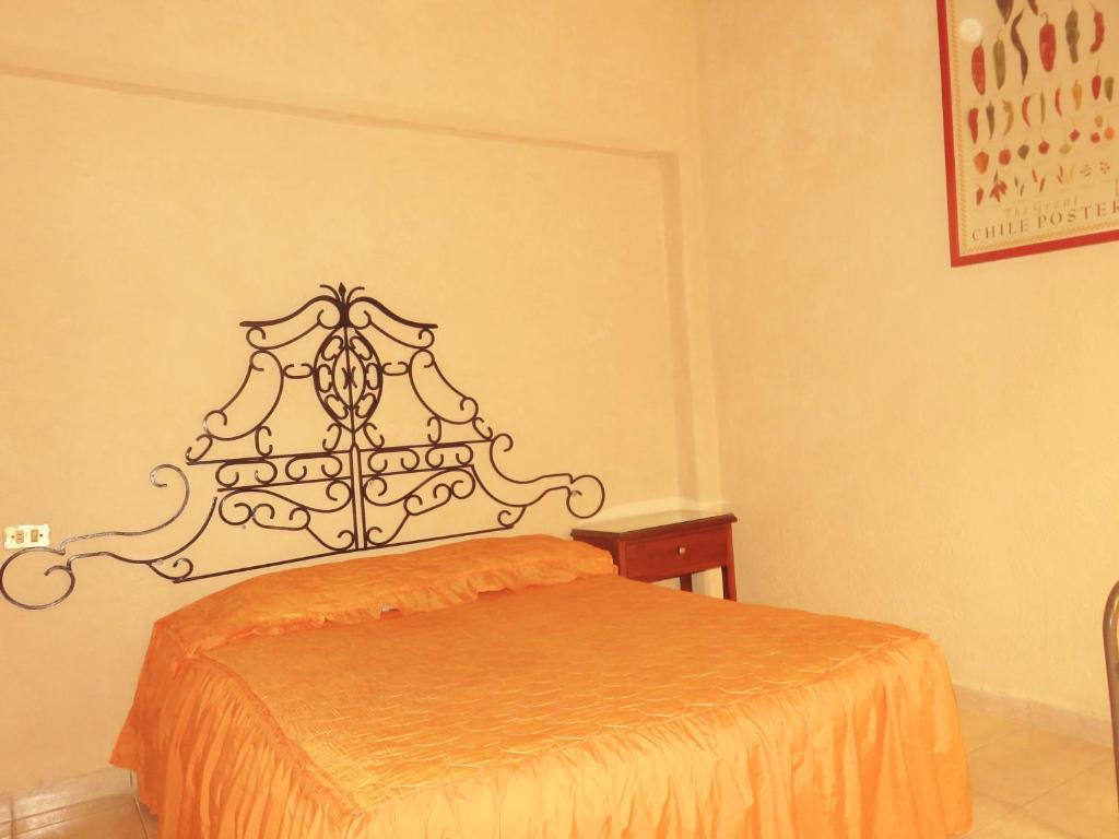 Cama o camas de una habitación en Hotel Los Reyes