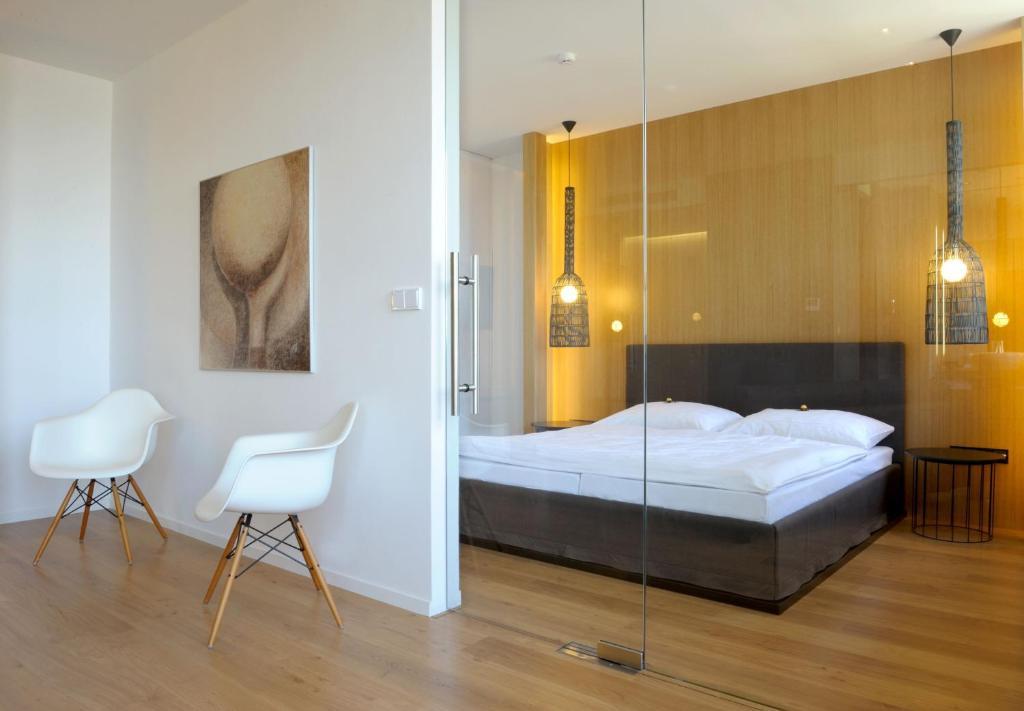 Postel nebo postele na pokoji v ubytování Hotel Tomášov