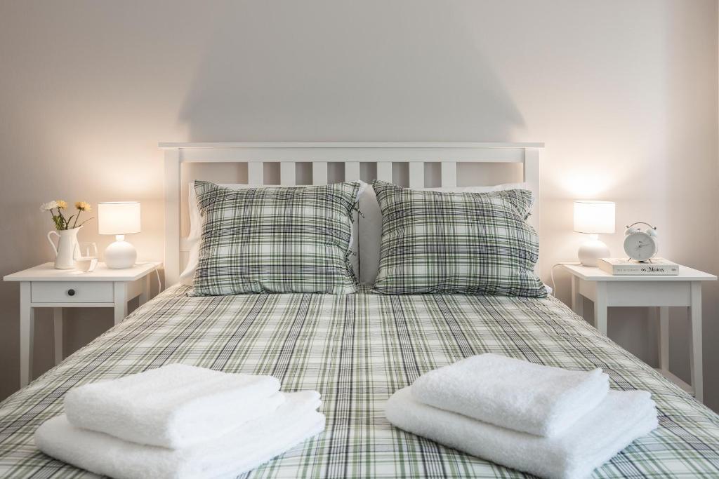 Cama ou camas em um quarto em Aveiro Train Flat
