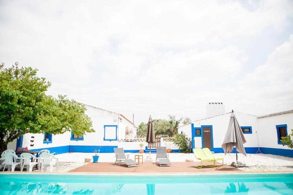 Swimmingpoolen hos eller tæt på Carrança Lounge