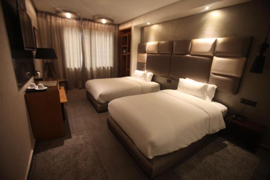 Отель  The Seven Hotel