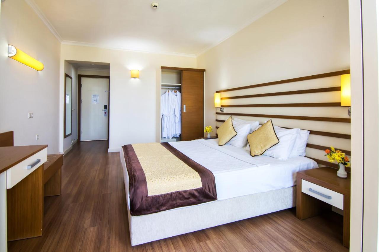 Кровать или кровати в номере Hotel Akbulut & Spa