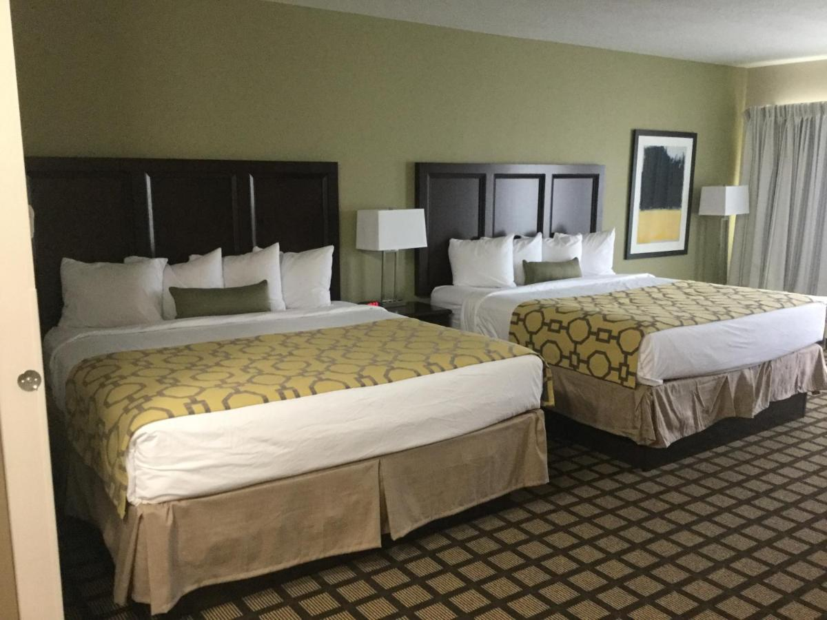 Un ou plusieurs lits dans un hébergement de l'établissement Baymont by Wyndham Page Lake Powell