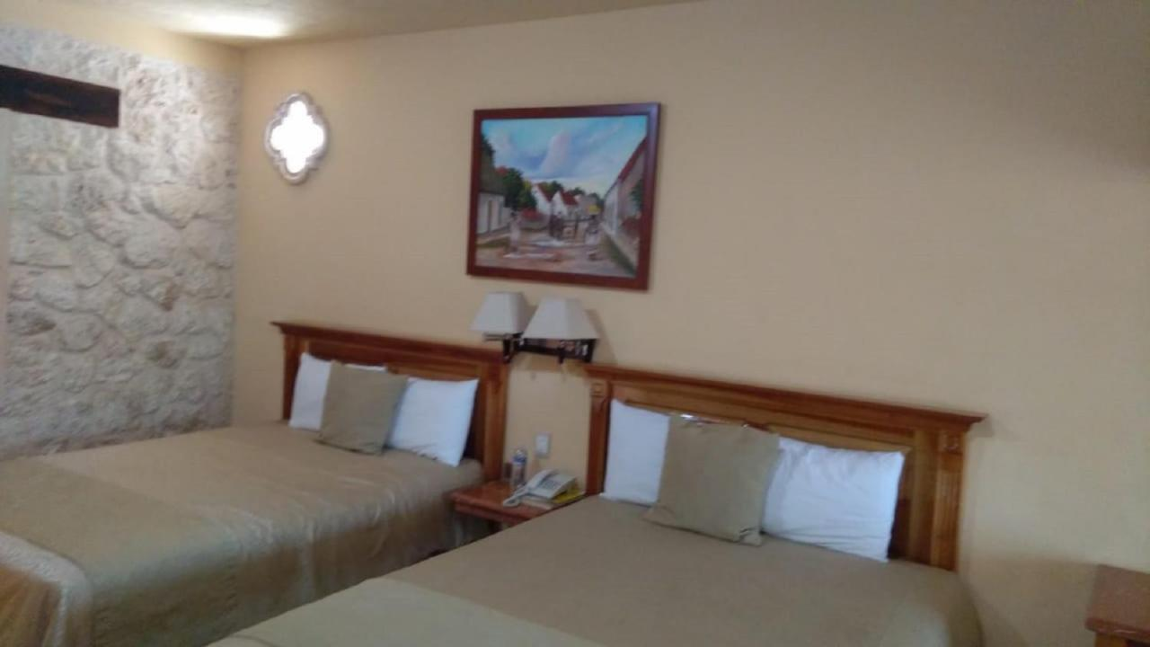 Отель  Cancun International Suites
