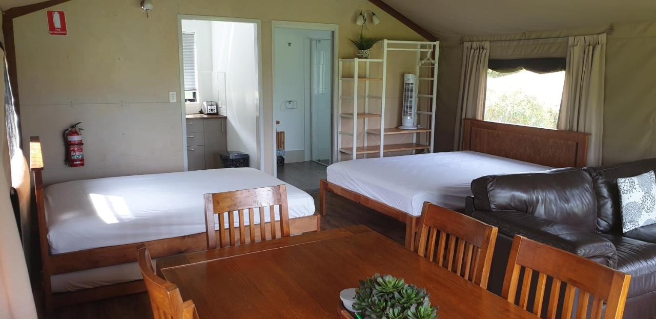 A bed or beds in a room at Southern Sky Glamping