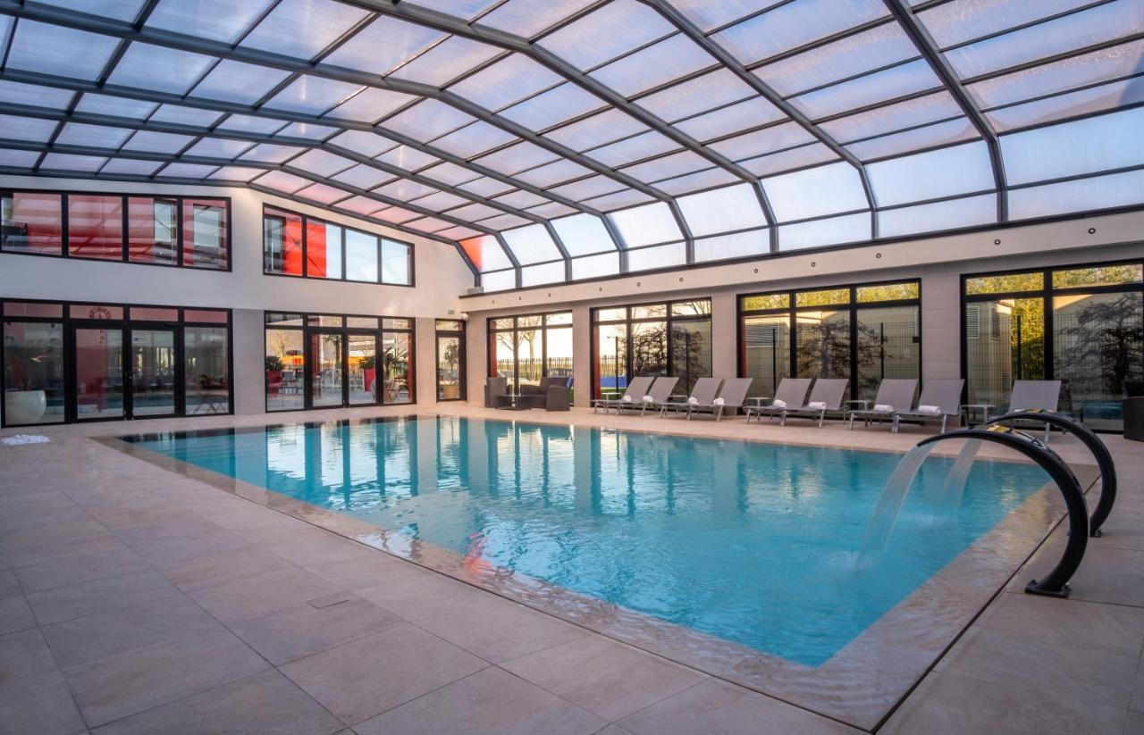 Отель  Kyriad Prestige Lyon Est - Saint Priest Eurexpo Hotel And SPA
