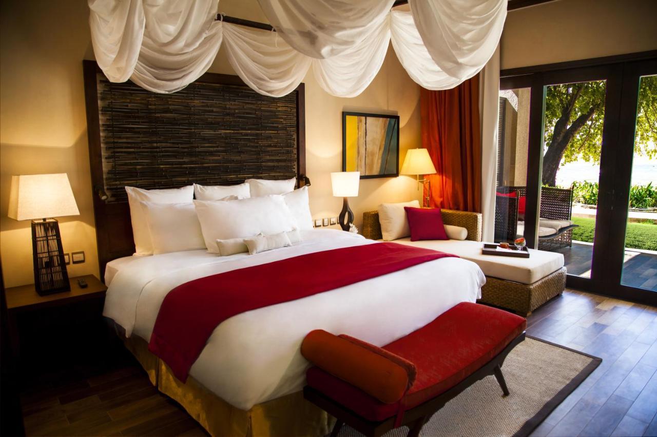 Un ou plusieurs lits dans un hébergement de l'établissement The H Resort Beau Vallon Beach