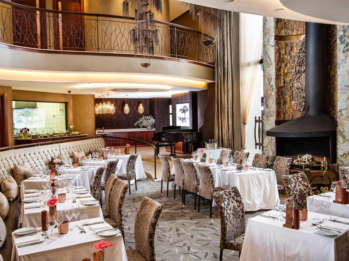 A restaurant or other place to eat at Kimberley Anne Hotel