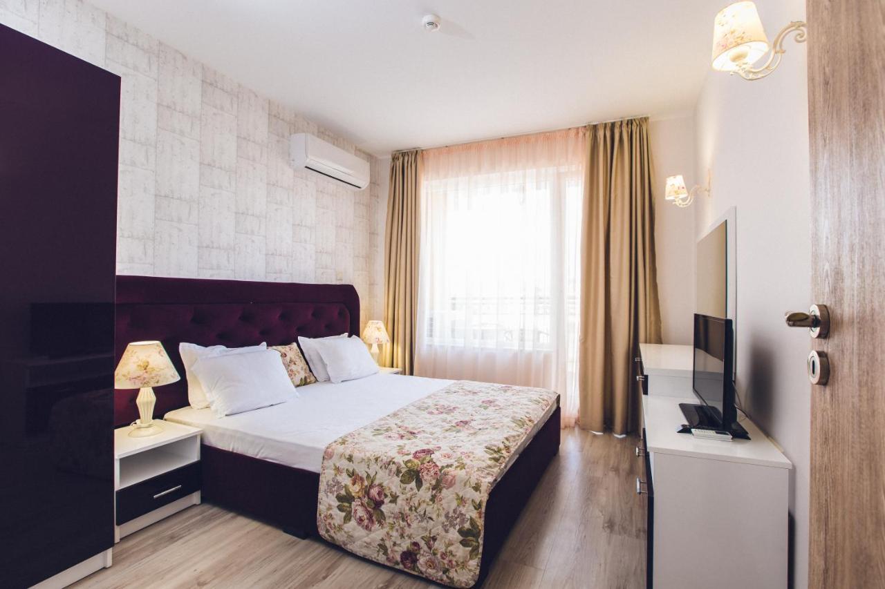 Кровать или кровати в номере Avenue Deluxe Hotel