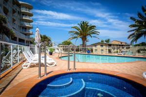 The swimming pool at or near Kirra Beach Apartments