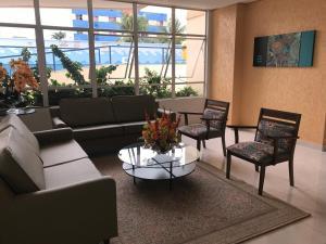 A seating area at Apartamento Thermas das Caldas Residencial
