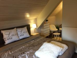 A bed or beds in a room at B&B Bora Bora