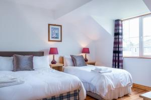 A bed or beds in a room at Killarney's Holiday Village