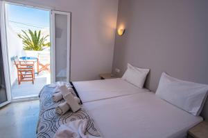 A bed or beds in a room at Katefiani Villas