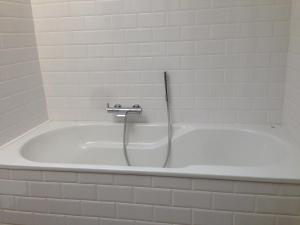 Ein Badezimmer in der Unterkunft Comfort Aan Zee Penthouse
