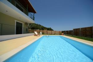 The swimming pool at or near Aselinos Suites