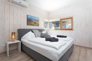 Ein Bett oder Betten in einem Zimmer der Unterkunft Designferienhaus