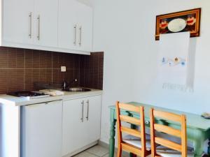 A kitchen or kitchenette at Filio Apartments
