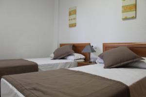 Ліжко або ліжка в номері Apartamentos Turisticos Caños de Meca