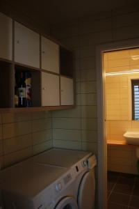 Kopalnica v nastanitvi Cosy two-floor apartment Vurnikov trg