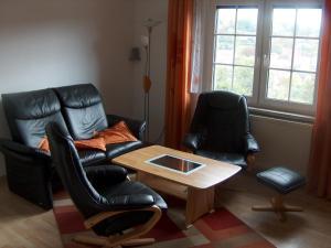 A seating area at Ferienwohnung Trollmann
